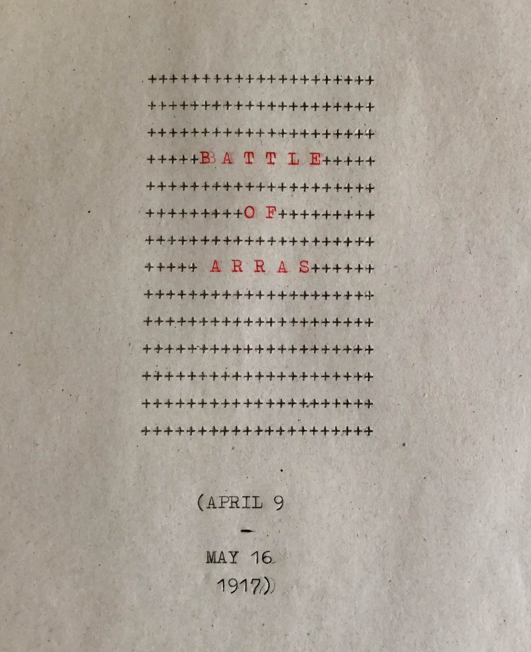 a sheet of paper, typewritten plus signs and in red the words