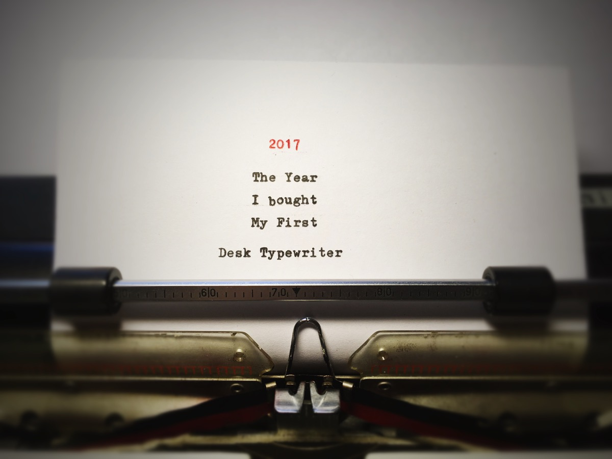 A paper in a typewriter, with text: