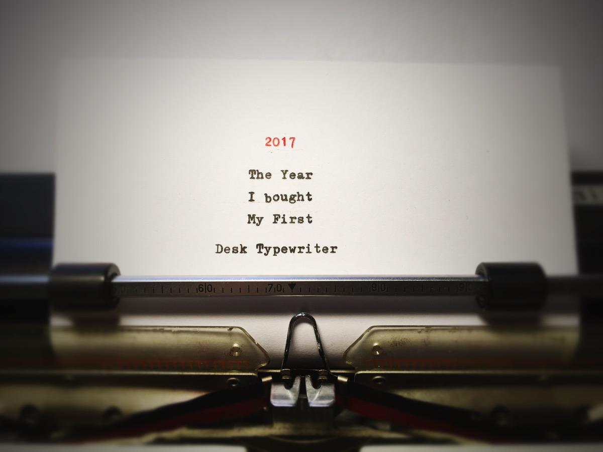 Paper in a  desktypewriter, text written: 2017 - The Year I bought My First Desk Typewriter